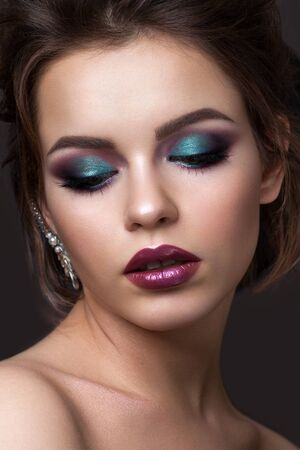 Photo for Beautiful young girl with evening colorful makeup and half closed eyes. Color lipstick with metall effect. - Royalty Free Image