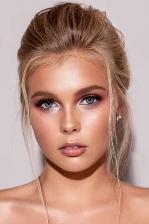 Photo for Young blond girl with gentle bridal makeup, perfect skin, rich lashes and locks falling on the face. - Royalty Free Image