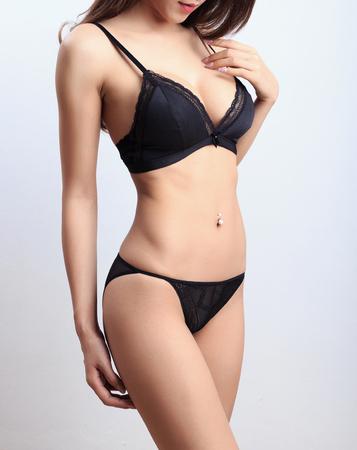 Photo pour Beautiful slim body of woman in studio - image libre de droit