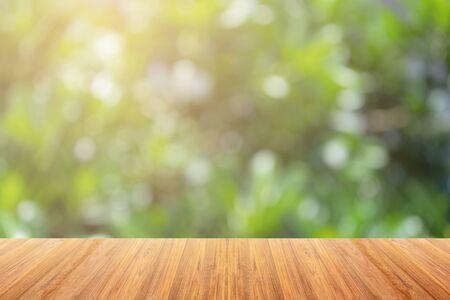Foto de Wooden board on Blurry Bokeh background For display products. - Imagen libre de derechos