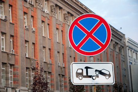 Photo for Street sign 'Stop and parking prohibited' on the background of beautiful building - Royalty Free Image