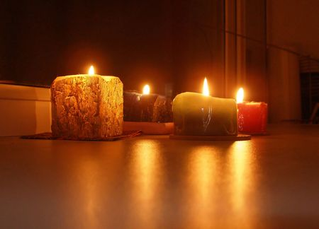 Alight festive candles