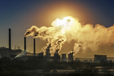 Foto de Factory pipe polluting air, environmental problem - Imagen libre de derechos