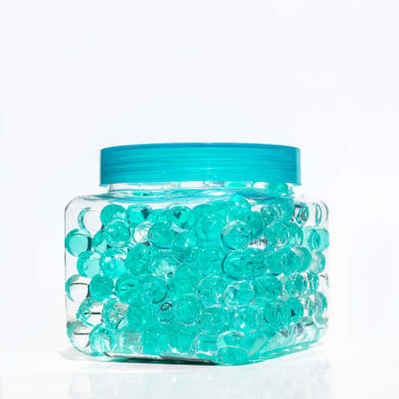 Photo pour Refreshing air blue balloons in a jar on a white background. Close up. Isolated. Fresh - image libre de droit