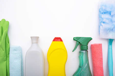 Photo pour on a white background colored brushes, rags, liquids and gloves for cleaning the house, close-up - image libre de droit