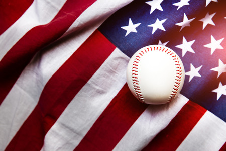 baseball with American flag in the backgroundの写真素材