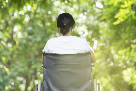 woman using a wheelchair in a park