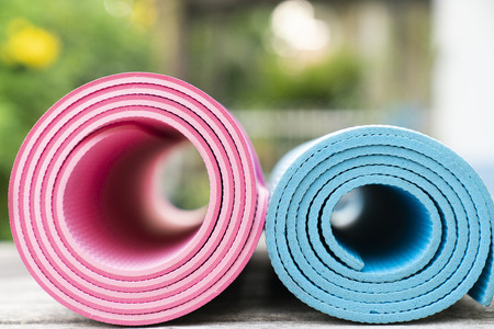 Photo for close up of yoga mats on the table, sport and healthy concept - Royalty Free Image