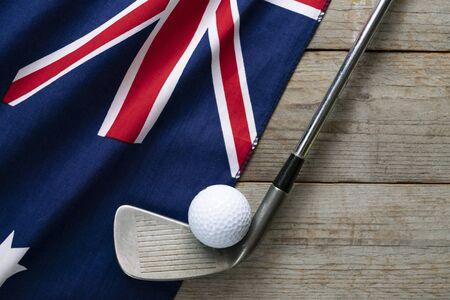 Photo pour Golf ball with flag of Australia on wood table - image libre de droit