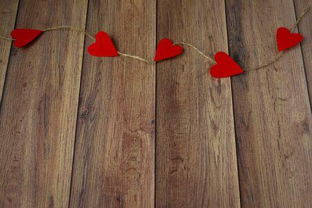 Foto für Background for Valentines Day. Garland of hearts on a wooden background. Valentine - Lizenzfreies Bild