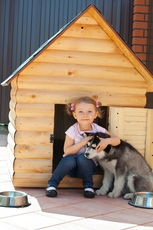 Child with a dog on the kennel