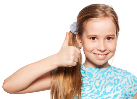Photo pour Happy girl showing thumb up. Happiness child showing sign okay - image libre de droit