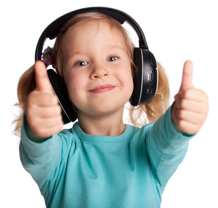 Happy child in headphones showing a thumb up