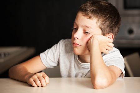 Photo pour Sad boy at home. Unhappy child. Emotions stress at teenager - image libre de droit