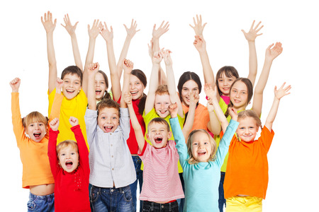 Foto de Happy group children isolated at white background. Smiling teen. Frendship boys and girls different ages - Imagen libre de derechos