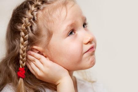Foto für Child has a sore ear. Little girl suffering from otitis - Lizenzfreies Bild