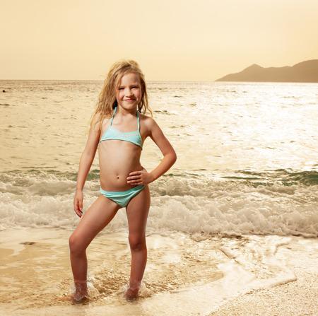 Photo pour Vacations. Girl on the beach. Sunset.  - image libre de droit