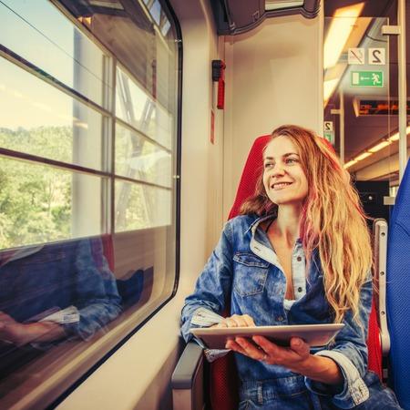 Photo pour Woman traveling by pablic transport - image libre de droit