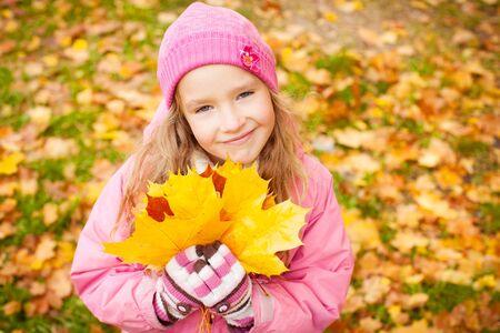Foto de Girl at autumn. Little child outdoors - Imagen libre de derechos