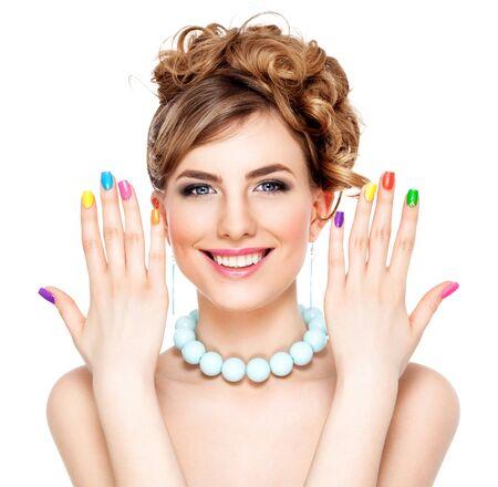 Photo pour Young woman portrait with colorful makeup and nail polish, manicure, studio shot - image libre de droit