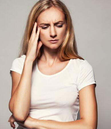 Photo pour Upset woman. Sad female Headache Problems - image libre de droit
