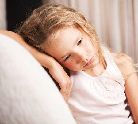 Photo pour Sad girl at home. Little child stress. Abuse - image libre de droit