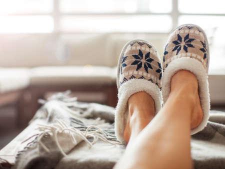 Photo pour Slippers on womens legs. Soft comfortable home slipper - image libre de droit