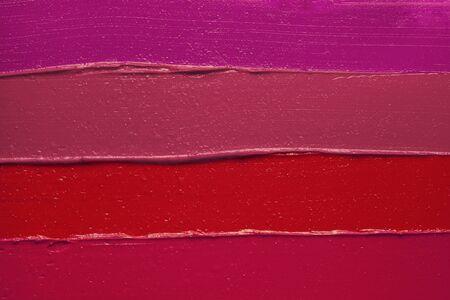 Photo pour Lipstick smudge wave red pink purple texture background - image libre de droit