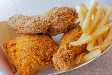 lunch set of crispy deep fried chicken and french fries, unhealthy eating