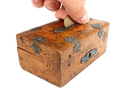 putting a romanian coin in very old moneybox