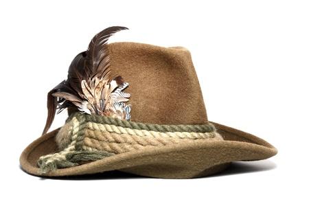 Foto de vintage woolen hunting hat decorated with feathers over white background - Imagen libre de derechos