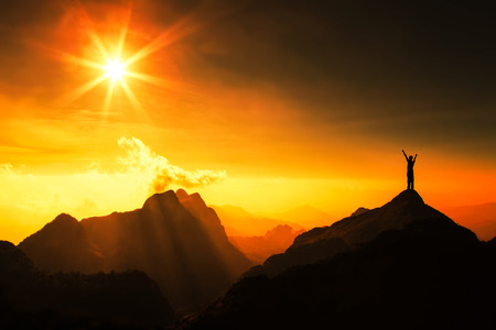 Photo for Silhouette of man on top of mountain with sunset. Conceptual scene. - Royalty Free Image