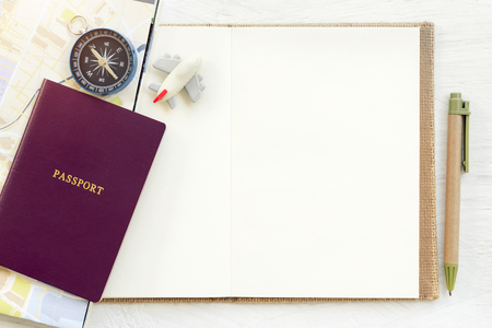 Travel background concept. Passport with plane and compass put on empty white paper for text. Picture for add text message. Backdrop for design art work.