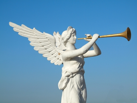 sculpture of an angel blowing golden horn