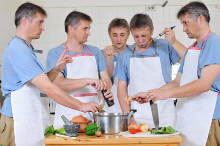 Composite of five cloned men trying to cook together but too many cooks have spoiled the broth