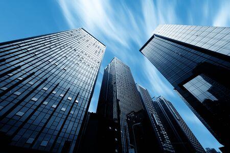 Photo pour Modern buildings in downtown and blue sunlight - image libre de droit