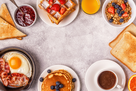 Photo pour Delicious breakfast on a light table. Top view, copy space. - image libre de droit