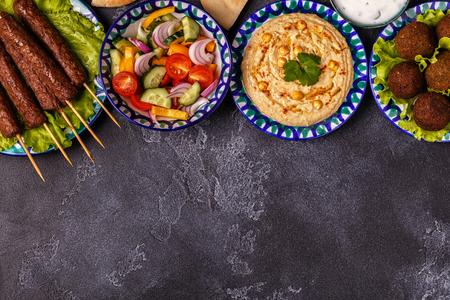 Photo pour Classic kebabs, falafel and hummus on the plates. Top view, copy space. - image libre de droit