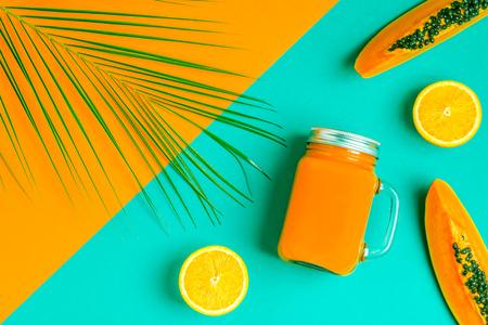 Foto de Smoothies / cocktail / juice on a bright pastel background, summer concept. - Imagen libre de derechos