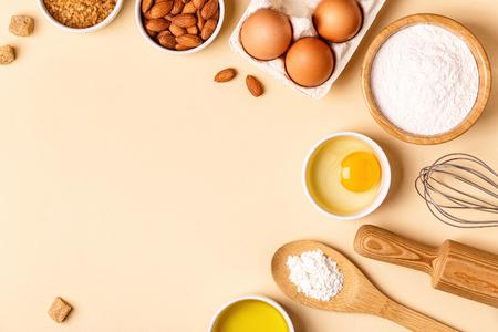 Foto de Ingredients and utensils for baking on a pastel background, top view. - Imagen libre de derechos