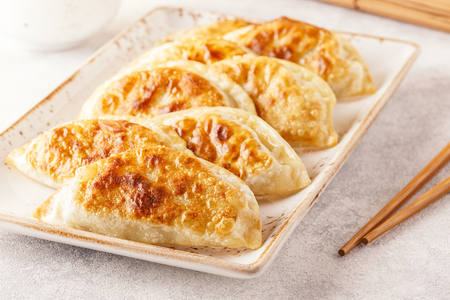 Photo for Plate of asian gyoza, dumplings snack with soy sauce. - Royalty Free Image