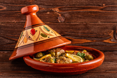 Photo for Traditional Moroccan chicken tagine with olives and salted lemons, selective focus. - Royalty Free Image