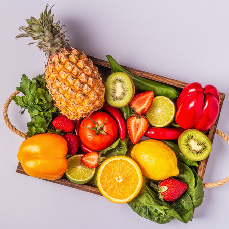 Foto de Fruits and vegetables rich in vitamin C in box. Healthy eating. Top view - Imagen libre de derechos