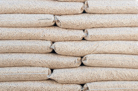 Heap of stacks of Pine pellets - stock image