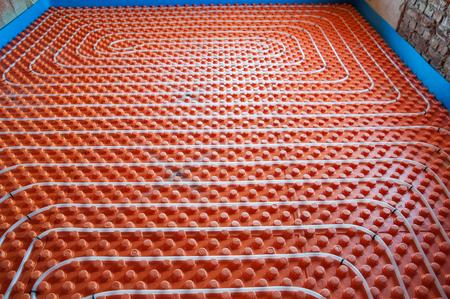 Underfloor heating sistem- pipes, instalation, orange base