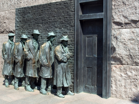 statues of unemployed men standing in a unemployment line during the Great Depression at the FDR Memorial in Washington, D.C.