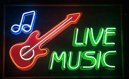 live music inscription and red guitar simbol