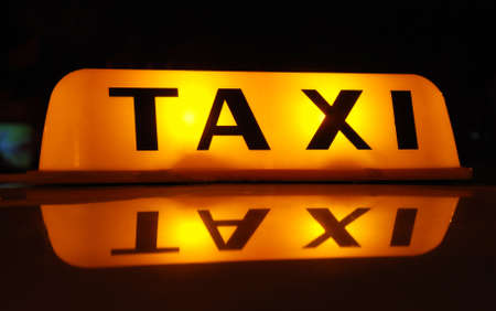 light TAXI inscription at the night