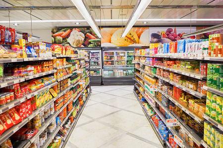 Foto für GENEVA, SWITZERLAND - SEPTEMBER 19, 2015: interior of Migros supermarket. Migros is Switzerland's largest retail company, its largest supermarket chain and largest employer - Lizenzfreies Bild
