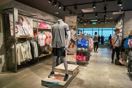 Photo pour SINGAPORE - CIRCA APRIL, 2019: interior shop of Adidas shop at Singapore Changi Airport. - image libre de droit
